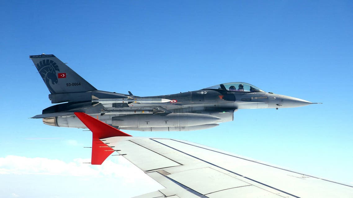 This photo taken on July 15, 2017 and released by Turkey's Presidential Press Service shows an F-16 fighter jet flying on the wing of the Turkey's president Recep Tayyip Erdogan's plane, while travelling from Ankara to Istanbul, to attend the July 15 Democracy and Unity Day commemoration of first year anniversary of the 2016 failed coup attempt.