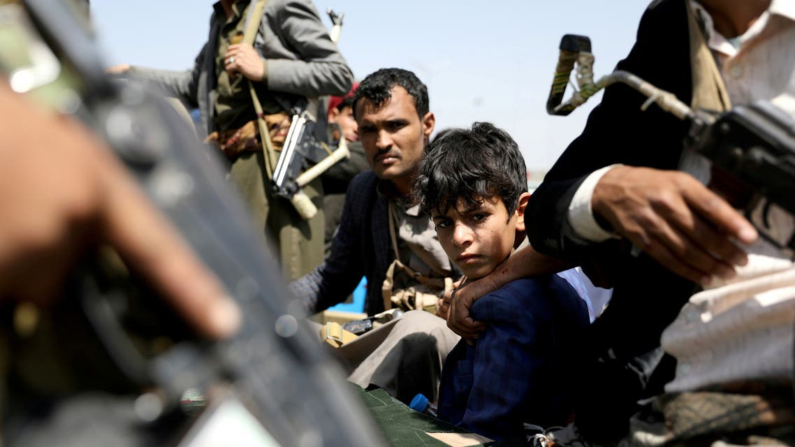 FILE PHOTO: A boy rides with Houthi followers on the back of a patrol truck during the funeral of Houthi fighters killed during recent battles against government forces, in Sanaa, Yemen September 22, 2020. REUTERS/Khaled Abdullah/File Photo