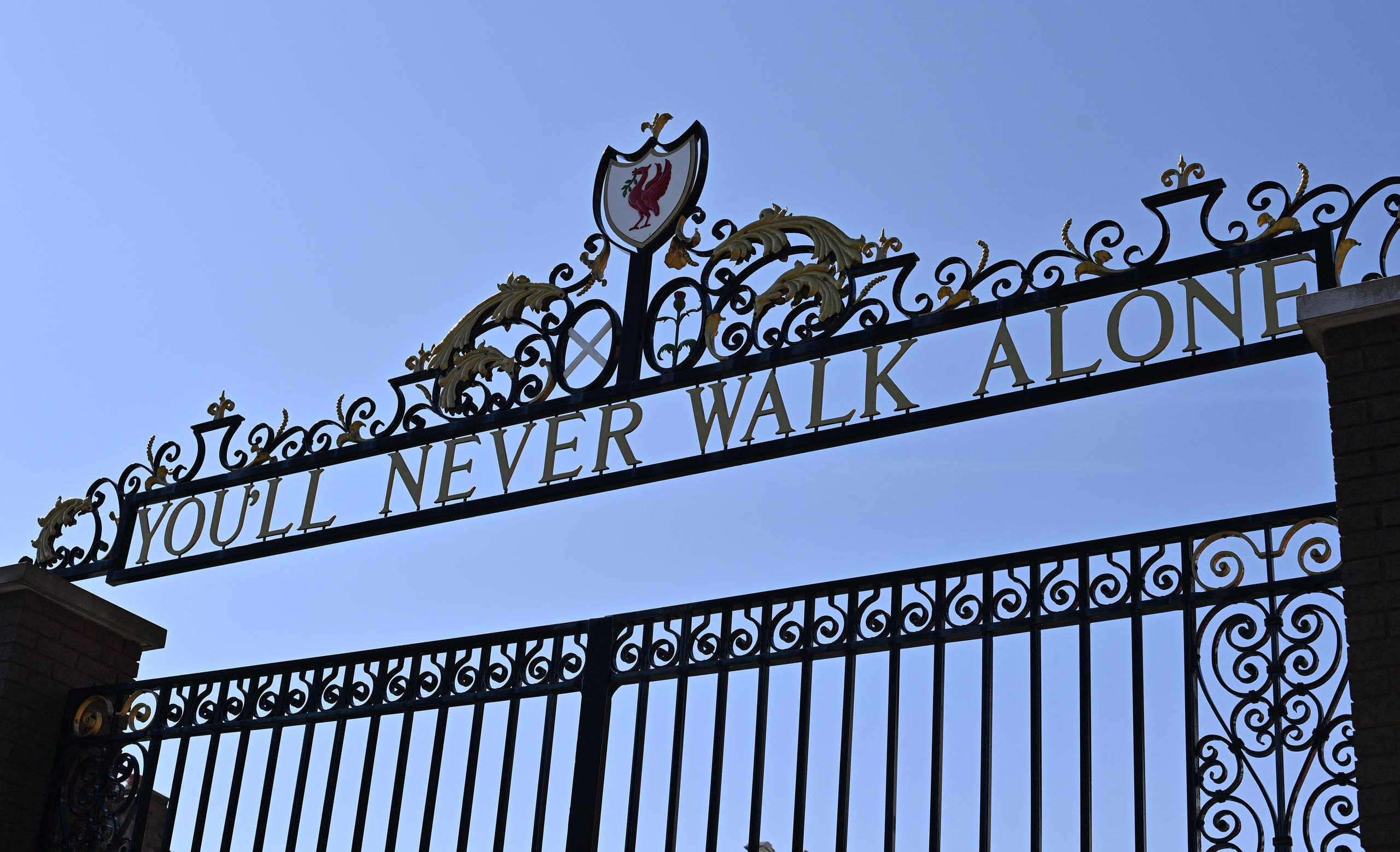 You'll Never Walk Alone, lyrics from a song by Gerry and the Pacemakers, is pictured on the Shankly Gates at Anfield stadium, home of English Premier League football club Liverpool, is pictured in Liverpool, north west England on April 19, 2021. (AFP)