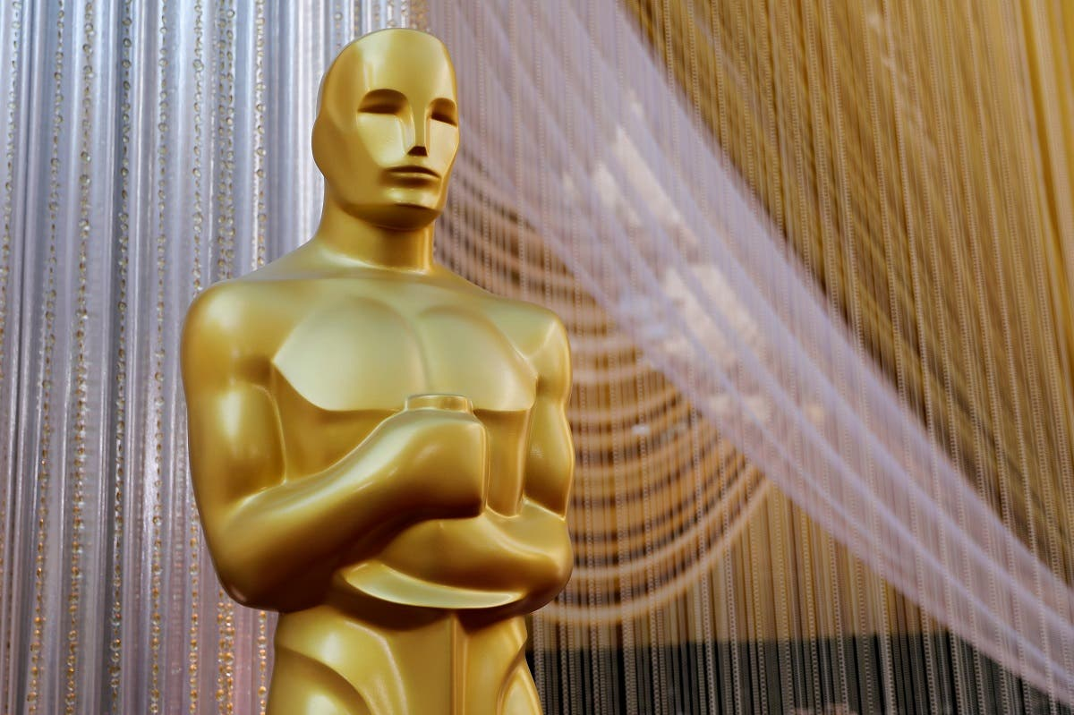An Oscar statue stands along the red carpet arrivals area in preparation for the 92nd Academy Awards in Los Angeles. (Reuters)