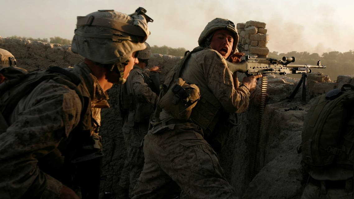 US Marines fire during a Taliban ambush as they carry out an operation to clear an area in Helmand province, Afghanistan, October 9, 2009. (Reuters)