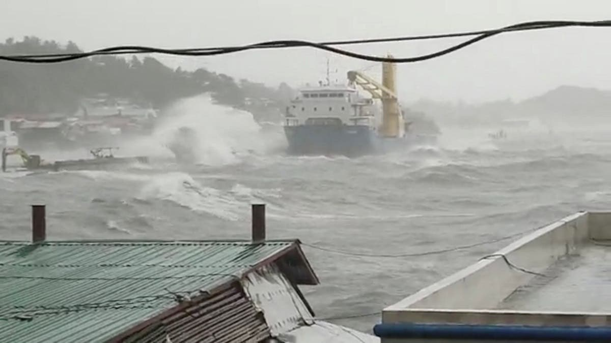 Waves crash the shore as Super Typhoon Surigae moves close to the Philippines in the province of Catbalogan, Samar, Philippines April 18, 2021, in this screen grab obtained from a social media video. (Reuters)