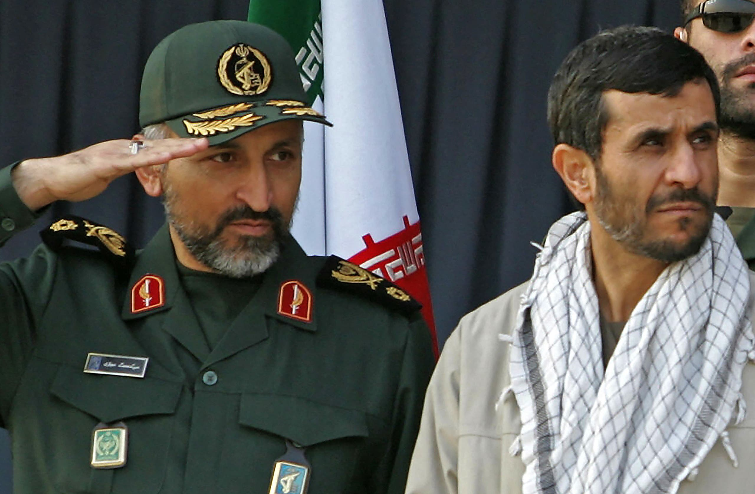In this file photo taken on November 26, 2006, former Iranian President Mahmoud Ahmadinejad (R) and Mohammad Hejazi attend a parade held by the Islamic volunteer Basij militia at the mausoleum of the late revolutionary founder Ayatollah Khomeini, just outside Tehran. (AFP)
