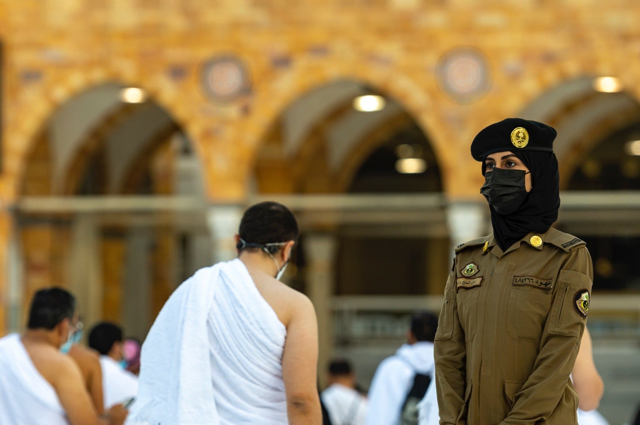 Photos of a Saudi female police officer supervising Umrah pilgrims during the holy month of Ramadan in Saudi Arabia's Mecca. (SPA)