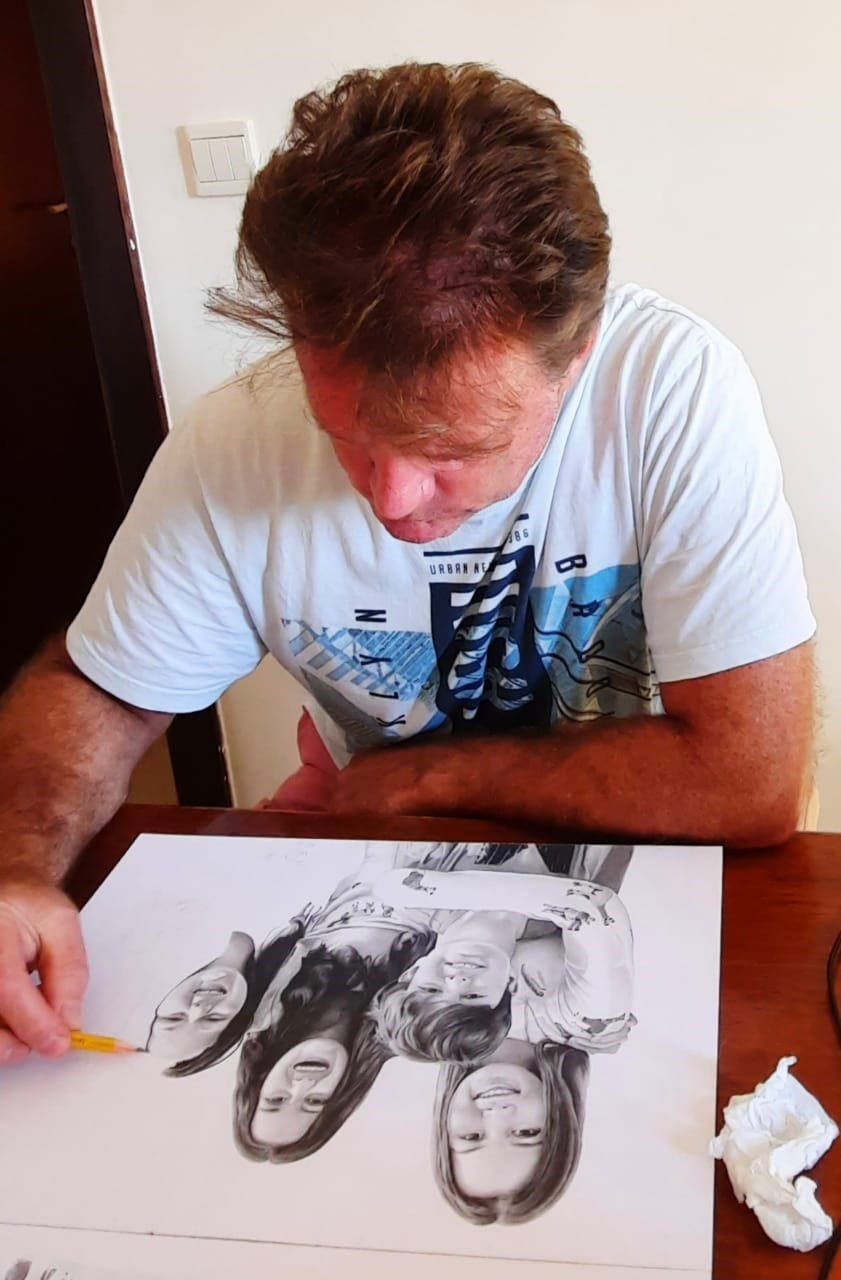 Dubai resident Adrian Wells sketching a comission after a career change. (Supplied)