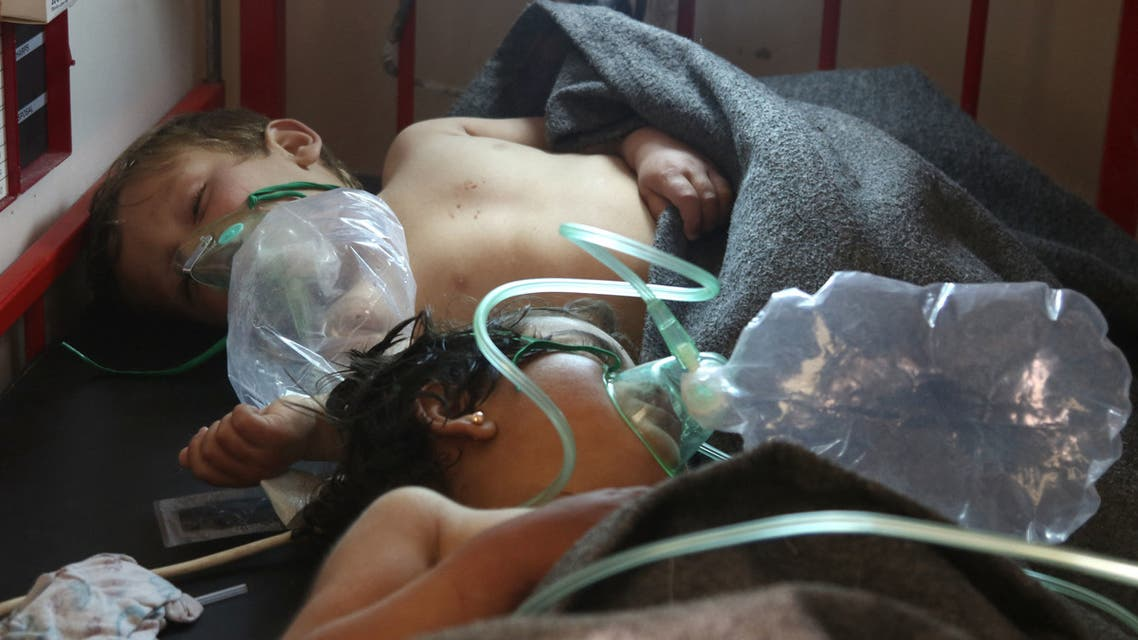 Syrian children receive treatment at a small hospital in the town of Maaret al-Noman following a suspected toxic gas attack in Khan Sheikhun, a nearby rebel-held town in Syria's northwestern Idlib province, on April 4, 2017. Warplanes carried out a suspected toxic gas attack that killed at least 35 people including several children, a monitoring group said. The Syrian Observatory for Human Rights said those killed in the town of Khan Sheikhun, in Idlib province, had died from the effects of the gas, adding that dozens more suffered respiratory problems and other symptoms.