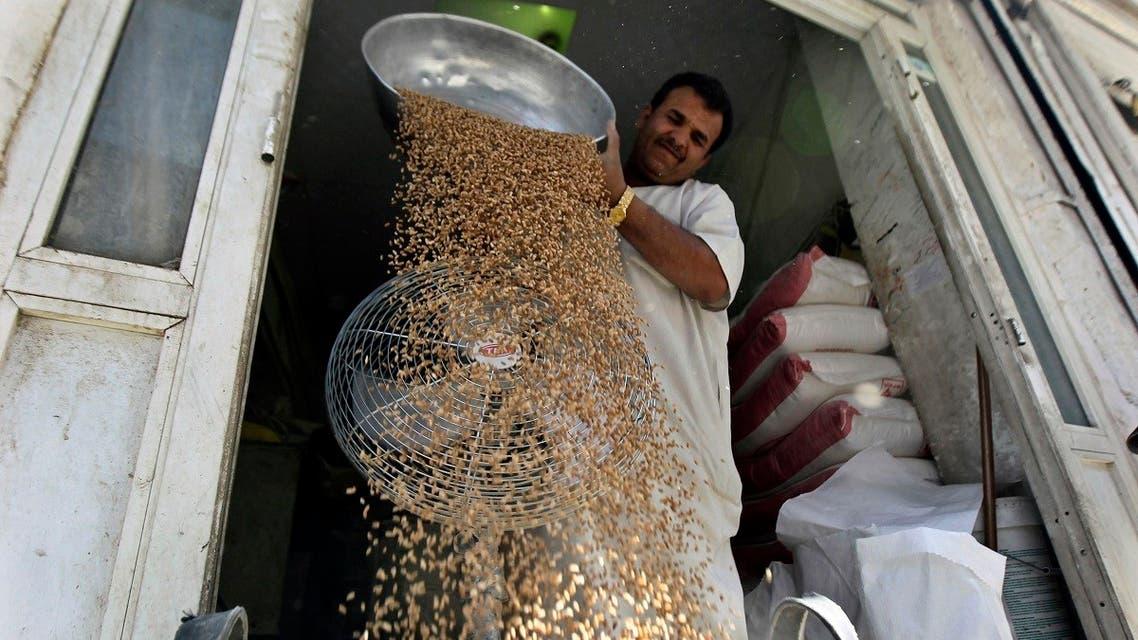 A file photo shows a man sorts wheat to be sold in Riyadh, Saudi Arabia. (Reuters/Faisal Al Nasser)