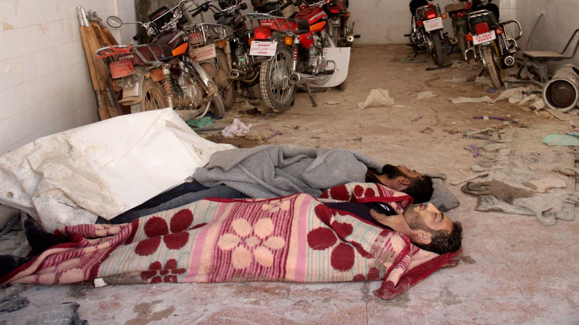 Bodies lie in the parking area of a hospital in Khan Sheikhun, a rebel-held town in the northwestern Syrian Idlib province, following a suspected toxic gas attack on April 4, 2017.