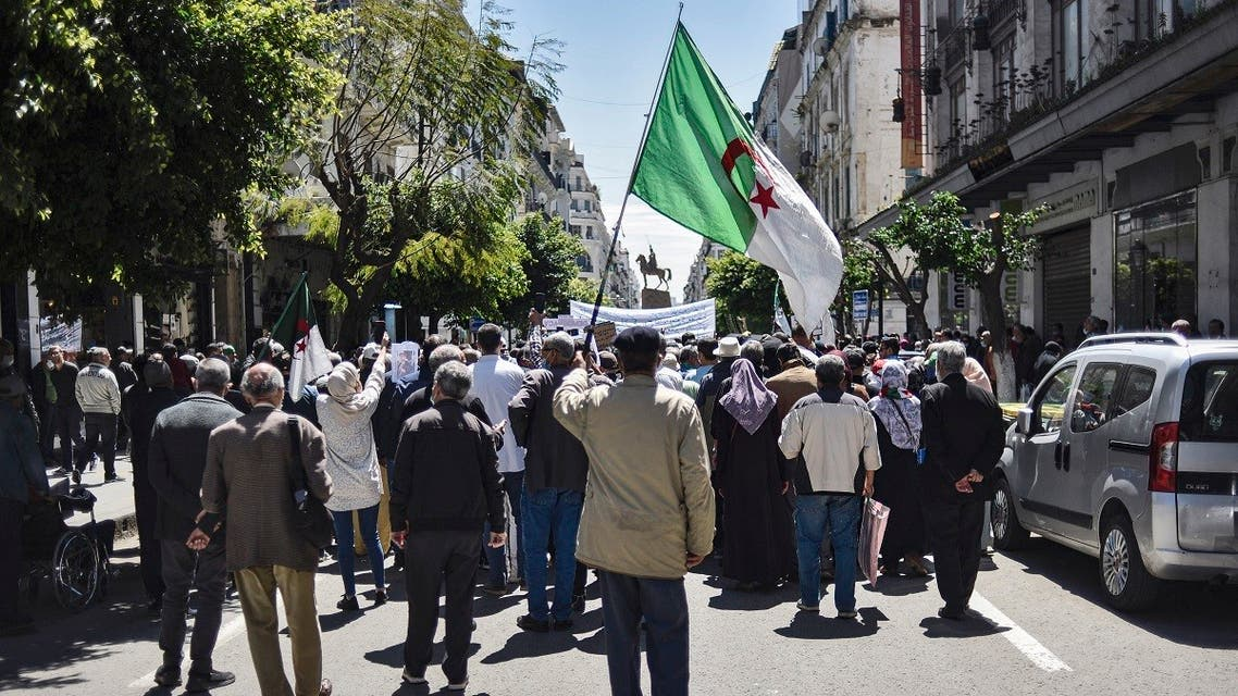 People chant slogans as they march during a student-led anti-government demonstration in Algeria's capital Algiers on April 20, 2021. (Ryad Kramdi/AFP)