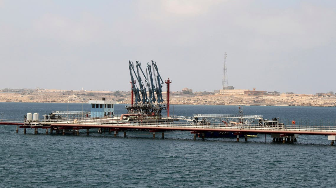 A view of pipelines and a loading berth of the Marsa al Hariga oil port in the city of Tobruk, east of Tripoli, Libya, August 20, 2013. REUTERS/Ismail Zitouny/File Photo