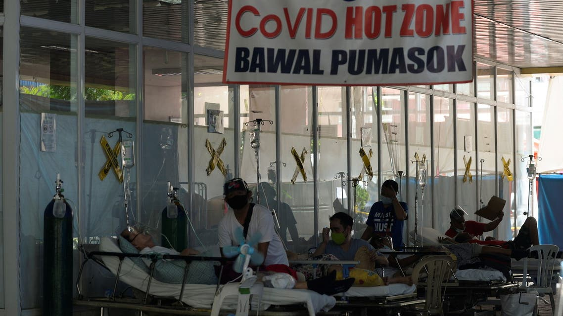 Suspected coronavirus disease (COVID-19) patients lie on hospital beds outside the emergency room of Amang Rodriguez Memorial Medical Center, in Marikina City, Metro Manila, Philippines. (Reuters)