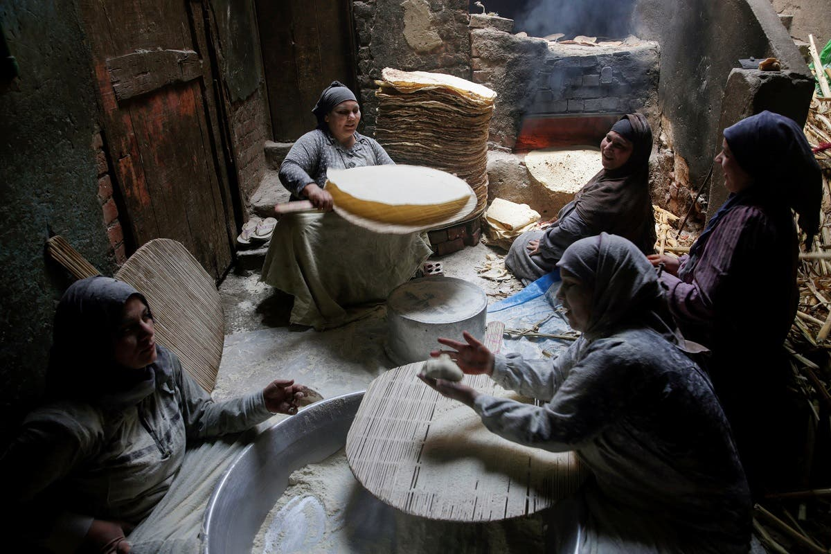 Nour El-Sabah, 35, prepares traditional food with her family to sell during the holy month of Ramadan in Beni Suef, Egypt.. (Reuters)