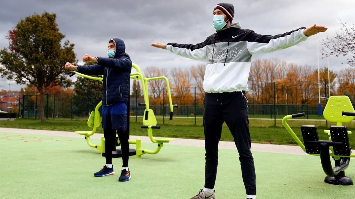 People wearing protective face masks train at an outdoor gym in Brussels. (File photo: Reuters)