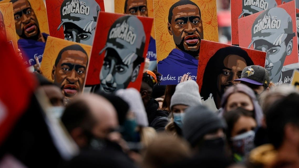 People hold placards after the verdict in the trial of former Minneapolis police officer Derek Chauvin, found guilty of the death of George Floyd, in Minneapolis, April 20, 2021. (Reuters)