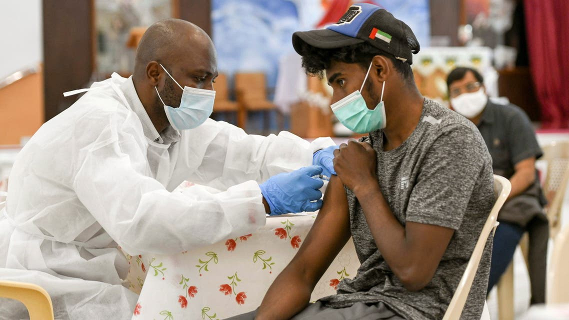 A man receives a dose of a vaccine against the coronavirus disease (COVID-19)at St. Paul's Church in Abu Dhabi, United Arab Emirates January 16, 2021. (Reuters)