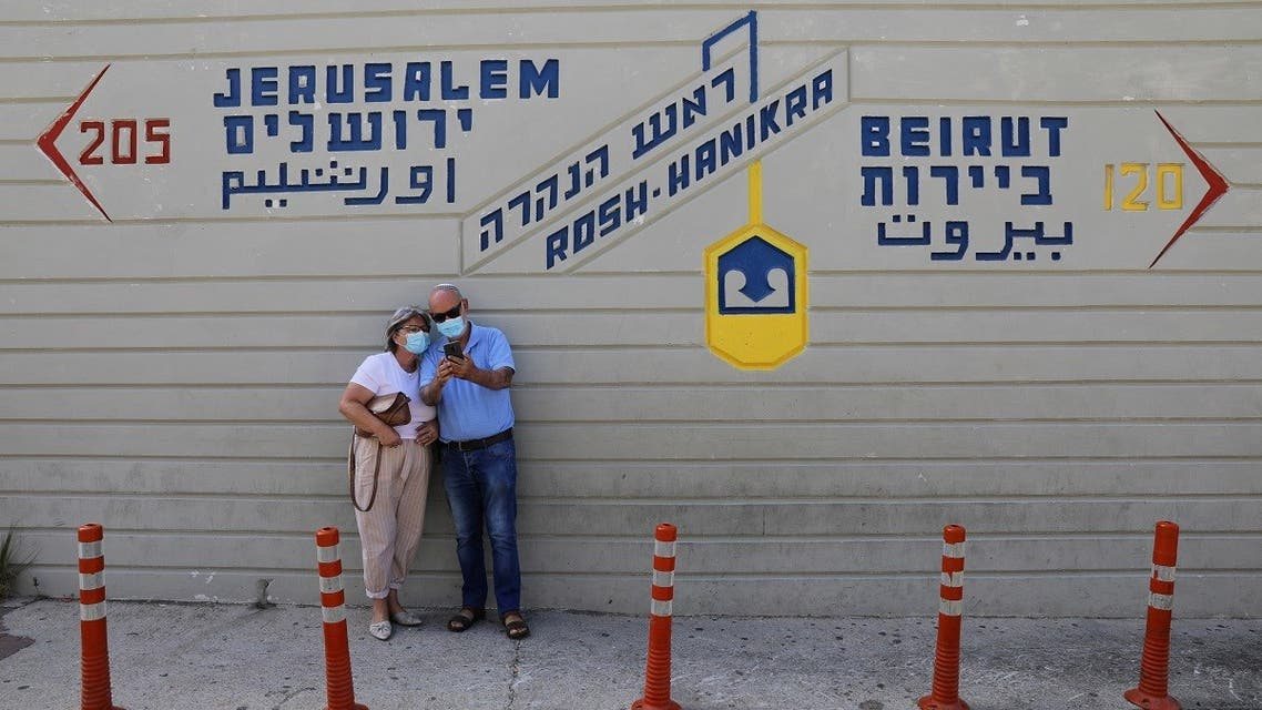 A couple visits the border crossing with Lebanon in northern Israel, Oct. 13, 2020. (Reuters)