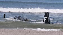 WWII plane makes emergency landing in waters off Florida beach