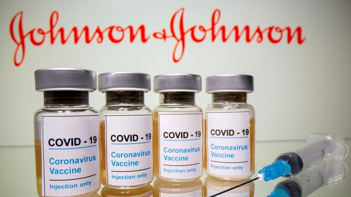 Vials and medical syringe are seen in front of a displayed Johnson & Johnson logo in this illustration taken October 31, 2020. (Reuters/Dado Ruvic)