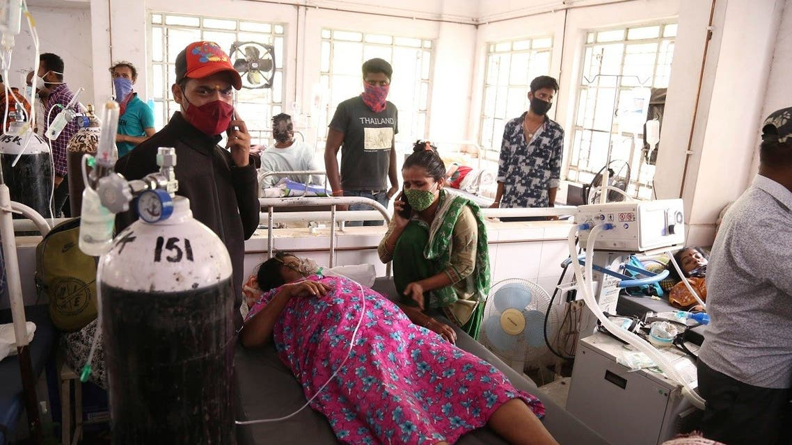 Patients use oxygen cylinders in hospital after a leakage in the oxygen plant in Nashik, in the Indian state of Maharashtra, Wednesday, on April 21, 2021 (AP)