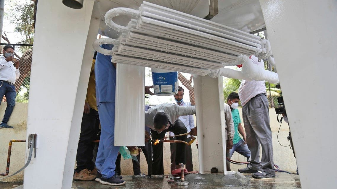 Hospital staff fix a leakage in their oxygen plant in Nashik, in the Indian state of Maharashtra, on April 21, 2021. (AP)