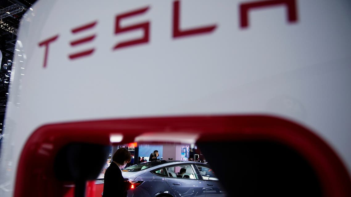 A Tesla electric vehicle (EV) is seen through a charging point displayed during a media day for the Auto Shanghai show in Shanghai, China April 20, 2021. (Reuters)