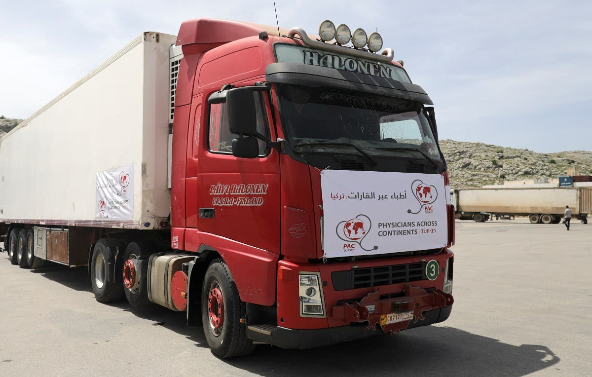 A truck carrying vaccines against the coronavirus disease (COVID-19) is seen at Bab al-Hawa crossing at the Syrian-Turkish border, in Idlib governorate, Syria, on April 21, 2021. (Reuters)