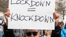 Protesters gather as German lawmakers vote on COVID-19 lockdown rules