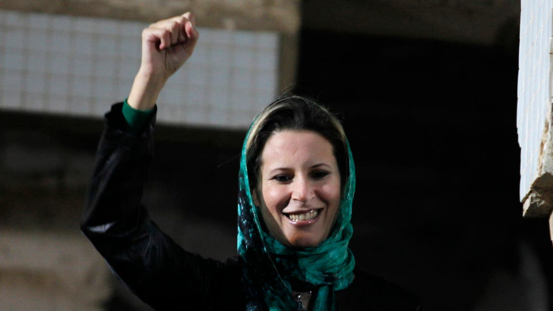 Aisha Gaddafi, daughter of Libya's leader Muammar Gaddafi, greets her father's supporters at the heavily fortified Bab al-Aziziya compound in Tripoli April 14, 2011. (Reuters)