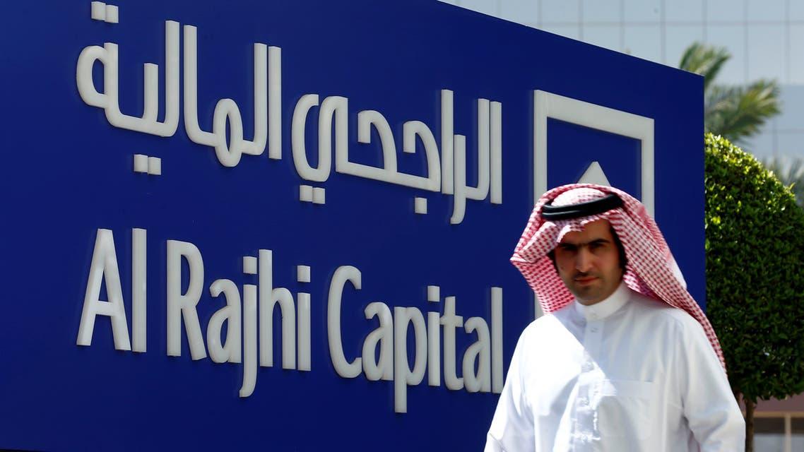A man walks past a sign of Al Rajhi Capital company in Riyadh. (Reuters)