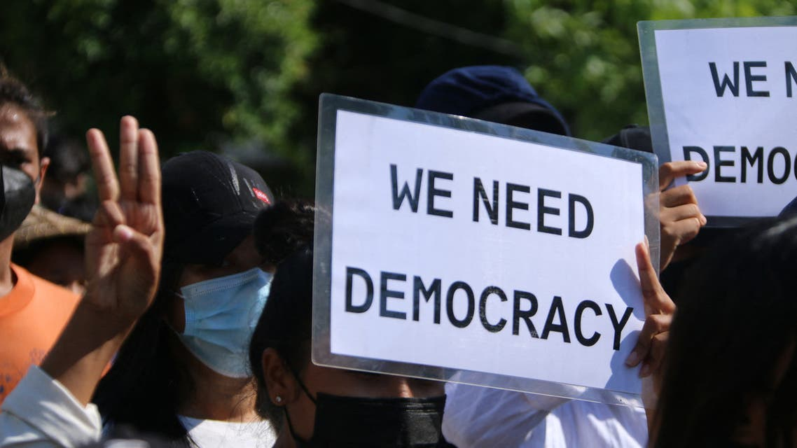 This handout photo taken and released by Dawei Watch on April 20, 2021 shows protesters holding signs as they march in a demonstration against the military coup in Dawei. (File photo: AFP)