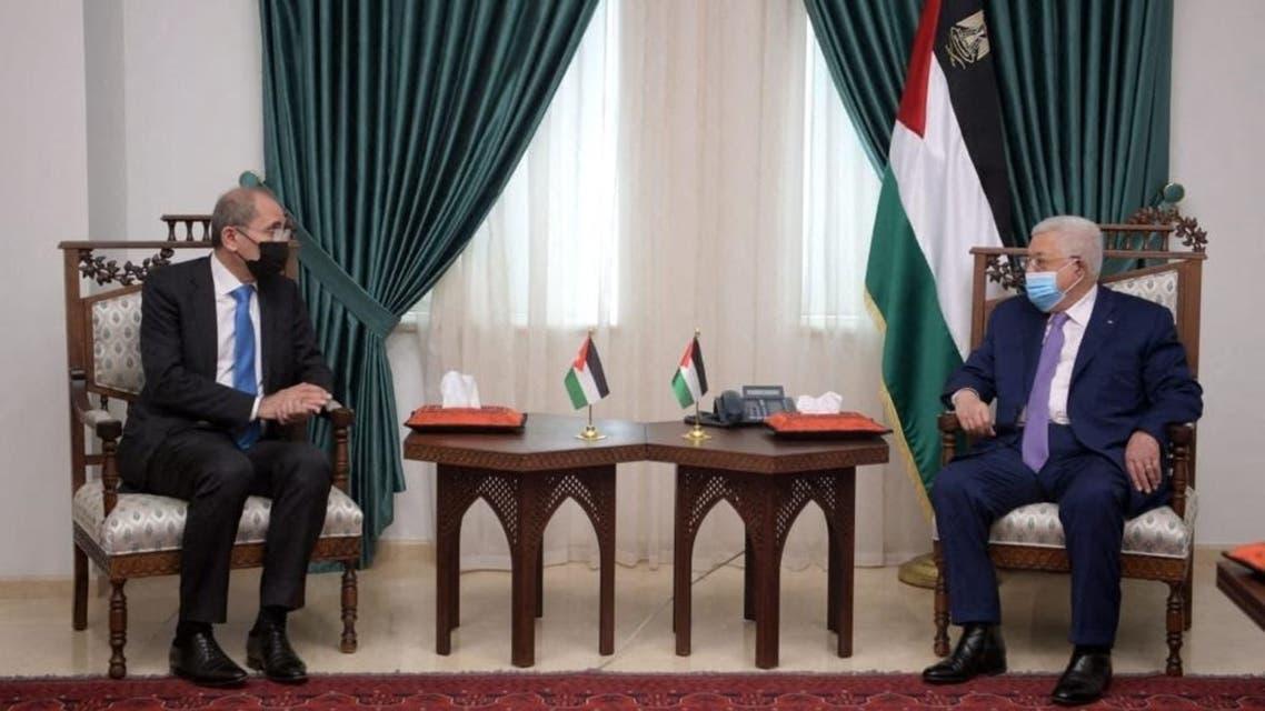 Palestinian President Mahmud Abbas (R) meeting with Jordan's Foreign Minister Ayman Safadi in Ramallah, April 21, 2021. (Jordanian Foreign Ministry/AFP)
