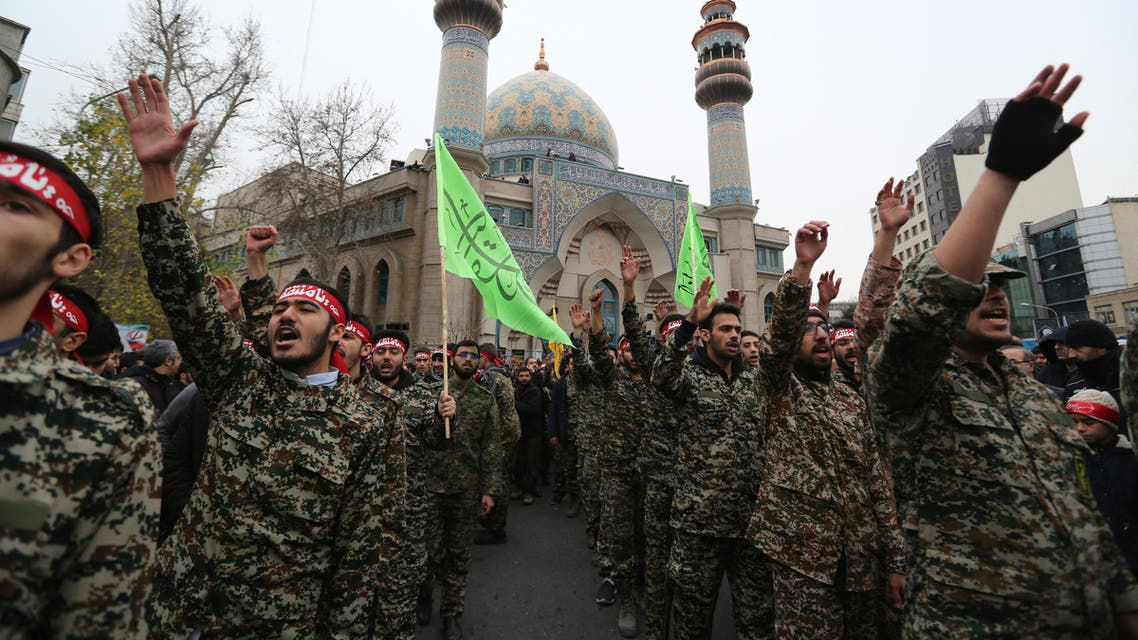 Iranian revolutionary guards take part in an anti-US rally to protest the killings during a US air stike of Iranian military commander Qasem Soleimani and Iraqi paramilitary chief Abu Mahdi al-Muhandis, in the capital Tehran on January 4, 2020. Soleimani, the 62-year-old deputy commander of the Revolutionary Guards, will be laid to rest next week in his hometown of Kerman as part of three days of ceremonies across the country, the Revolutionary Guards said.
