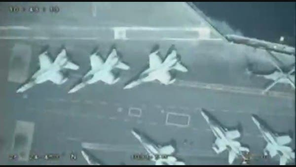 Iran's IRGC releases drone footage of US aircraft carrier and 'suicide drone test'