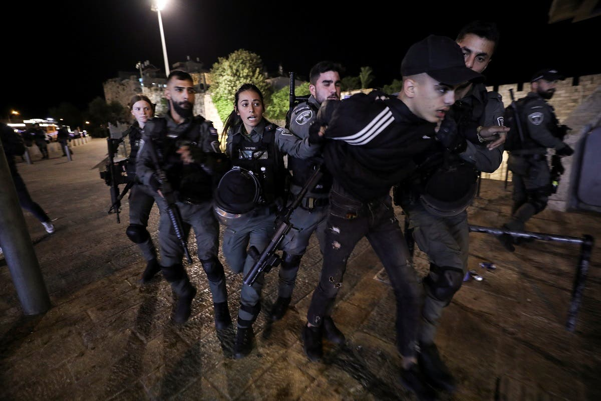 Israeli border police detain a Palestinian youth during clashes near Damascus Gate just outside Jerusalem's Old City, on the Muslim holy fasting month of Ramadan on April 21, 2021. (Reuters)