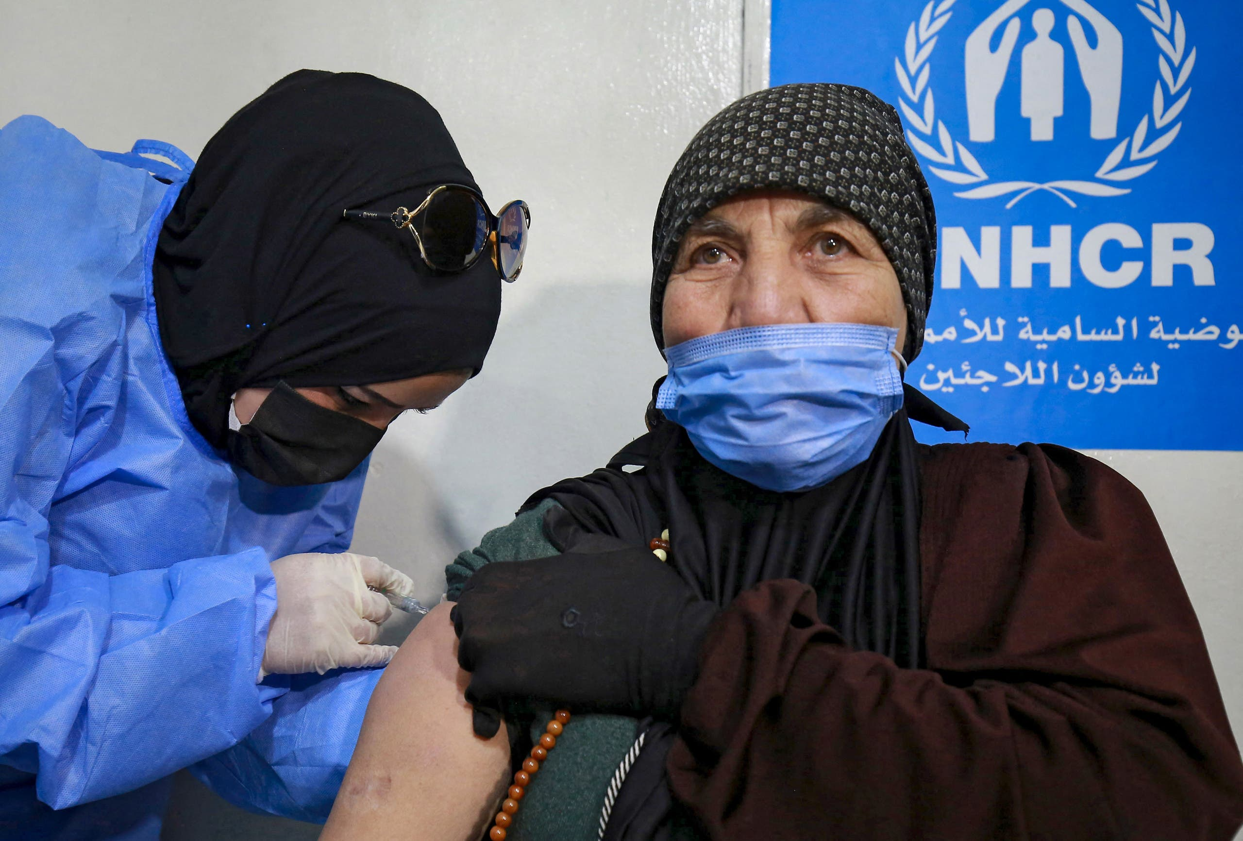 A Syrian refugee receives the Coronavirus vaccine, at a medical center in the Zaatari refugee camp, 80 kilometers (50 miles) north of the Jordanian capital Amman on February 15, 2021. (File photo: AFP)