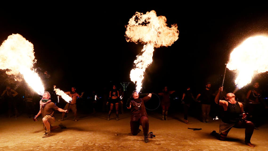 Burning Man participants from the Northern Fire Dynamic fire conclave out of Minnesota, Wisconsin and Iowa breath fire simultaneously during their fire dance performance in front of the effigy of The Man just before it was burned at the culmination of the annual Burning Man arts and music festival in the Black Rock desert of Nevada, US September 2, 2017. (File photo: Reuters)