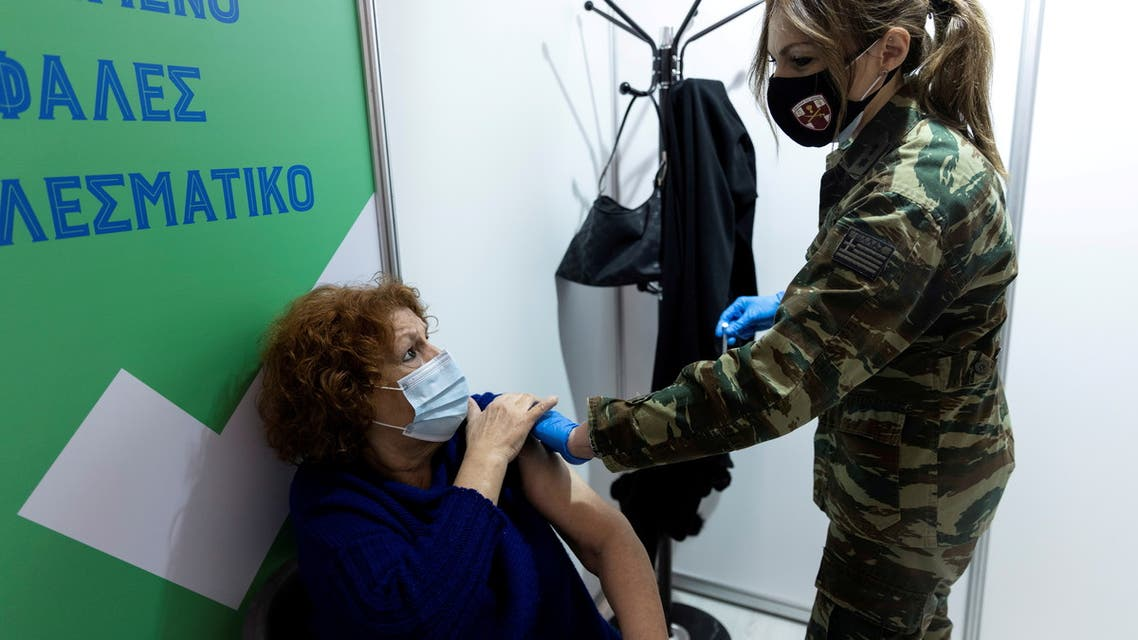 A woman speaks with a military doctor after receiving a dose of the Moderna vaccine against the coronavirus disease (COVID-19) at a newly opened vaccination center in Athens, Greece, April 2, 2021. (File Photo: Reuters)