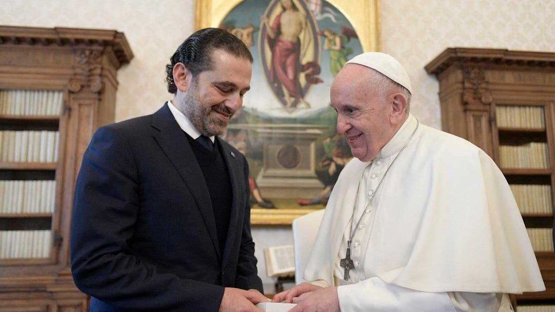 Pope Francis and Lebanon's prime minister-designate Saad Hariri exchanging gifts during a private audience in The Vatican, April 22, 2021. (AFP)