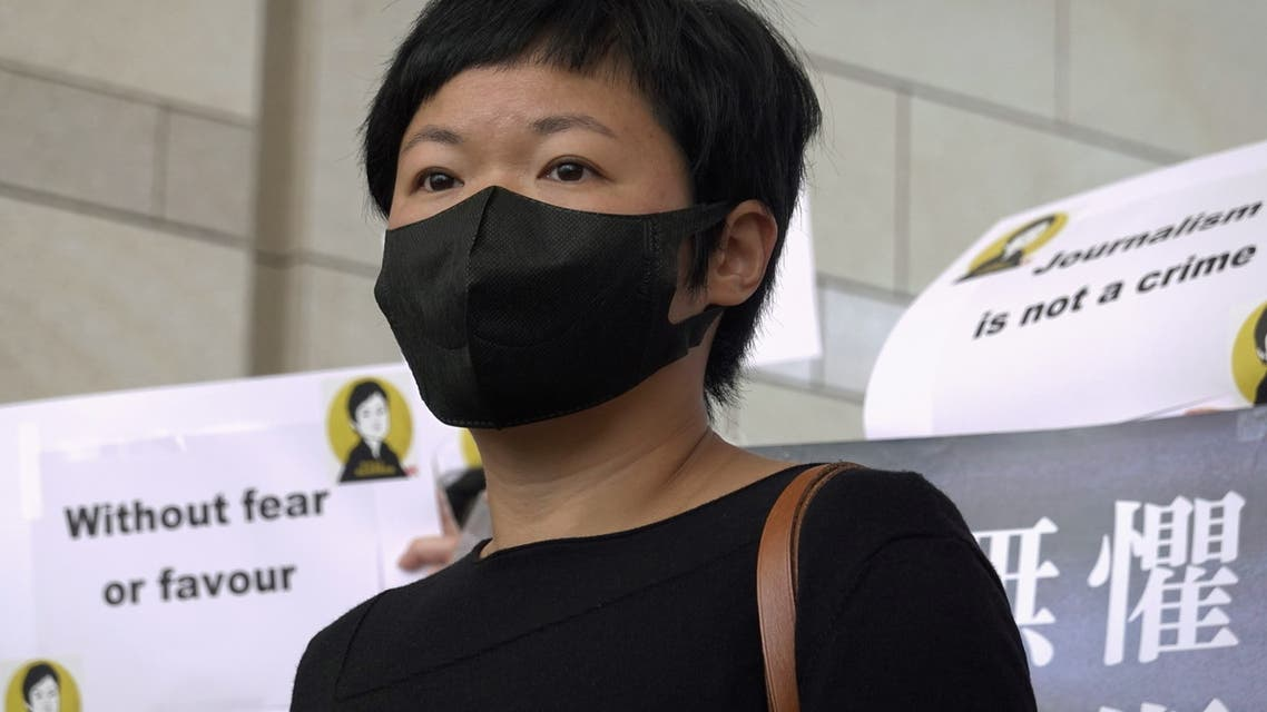 Bao Choy Yuk-Ling, a freelance journalist with RTHK, poses for pictures outside West Kowloon Magistrates' Courts as she arrives for charges of making a false statement to obtain data for a documentary on the police's handling of a mob attack, in Hong Kong, China April 22, 2021. (Reuters)