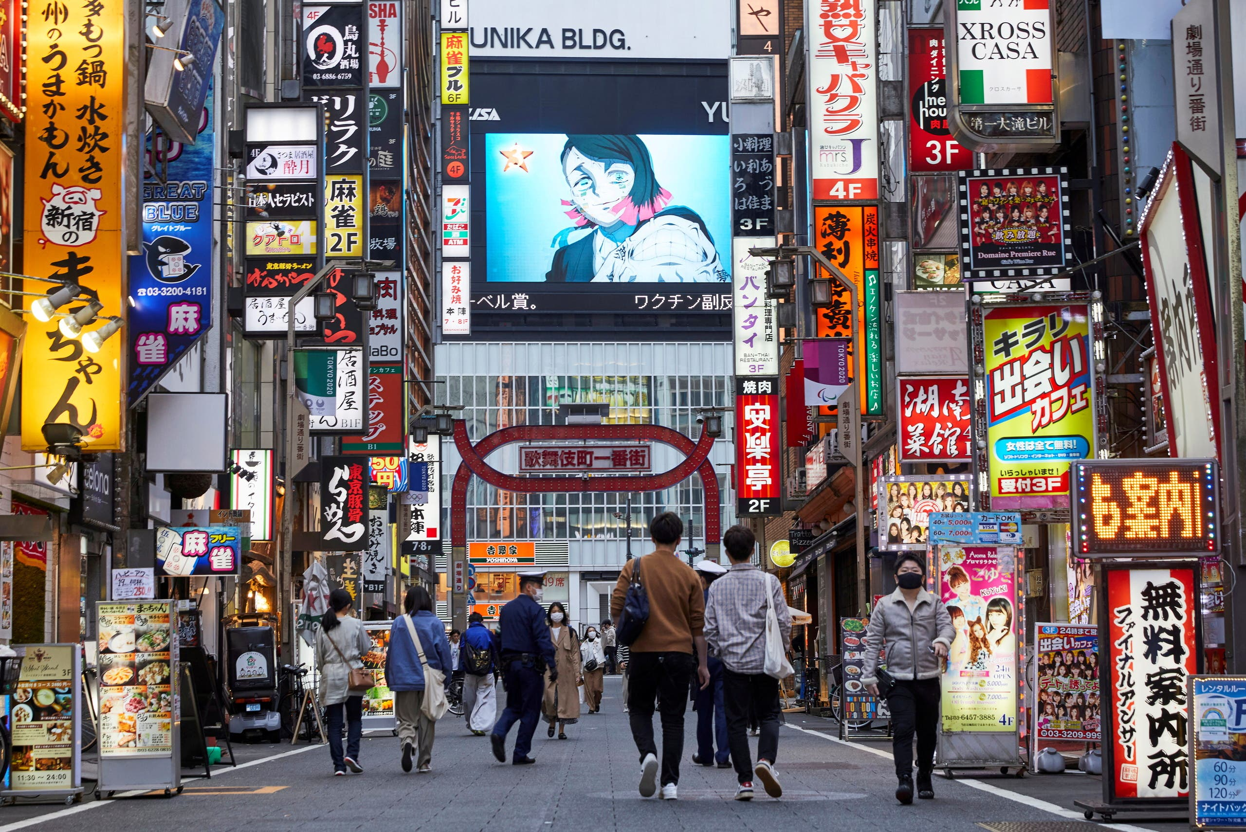 Passersby wearing protective masks stroll through Kabukicho entertainment district during the COVID-19 pandemic in Tokyo, Japan April 6, 2021. Picture taken April 6, 2021. (File Photo: Reuters)
