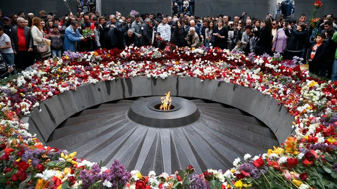 People lay flowers at a memorial to Armenians killed by the Ottoman Turks, as they mark the centenary of the genocide, in Yerevan, Armenia, April 24, 2015. (AP)