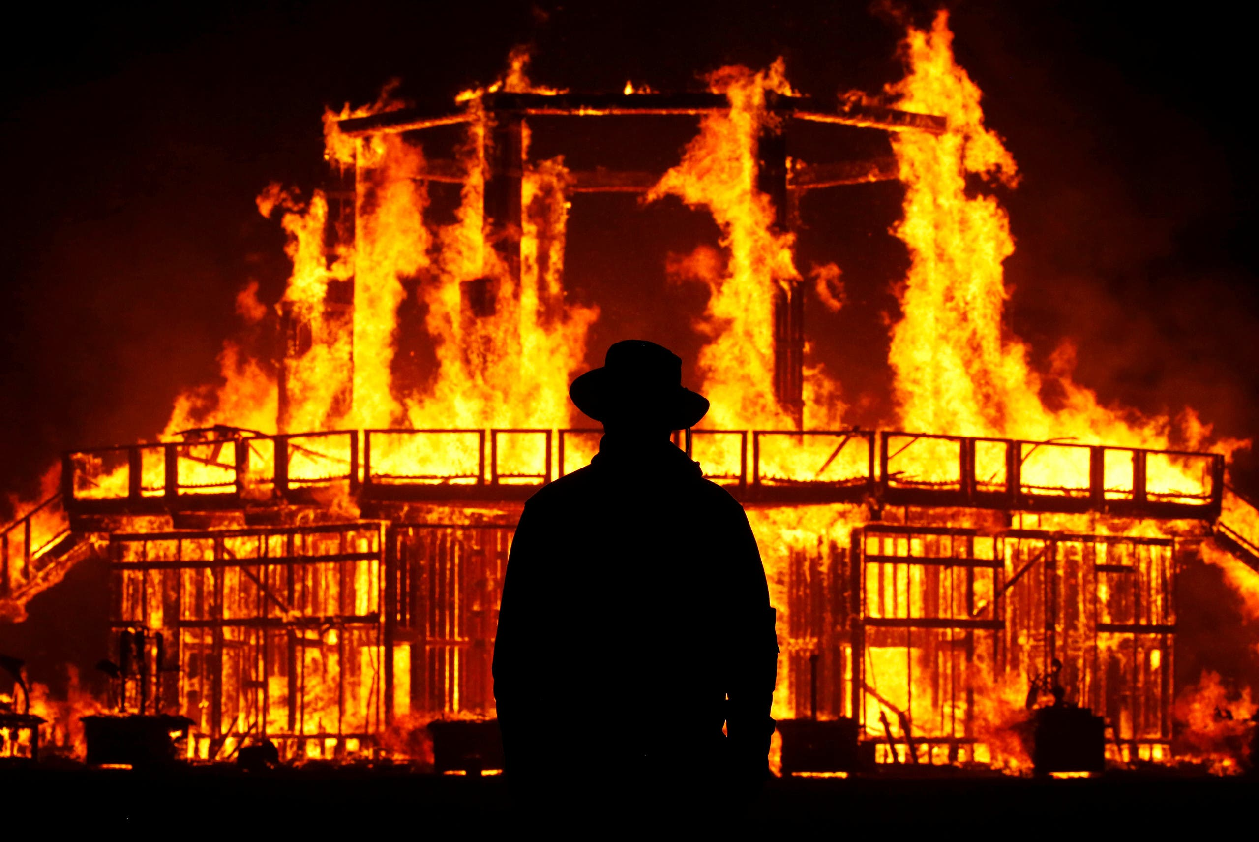 A Burning Man Ranger guards the inner perimeter around the effigy of The Man as it burns at the culmination of the annual Burning Man arts and music festival in the Black Rock desert of Nevada, US September 2, 2017. (File photo: Reuters)