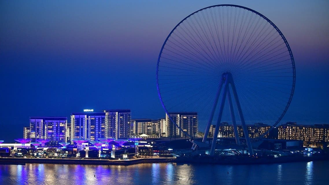 A boat sails in front of the Ain Dubai (Dubai Eye) ferris wheel located on the Bluewaters island in the Gulf city of Dubai, on May 28, 2020. (AFP)
