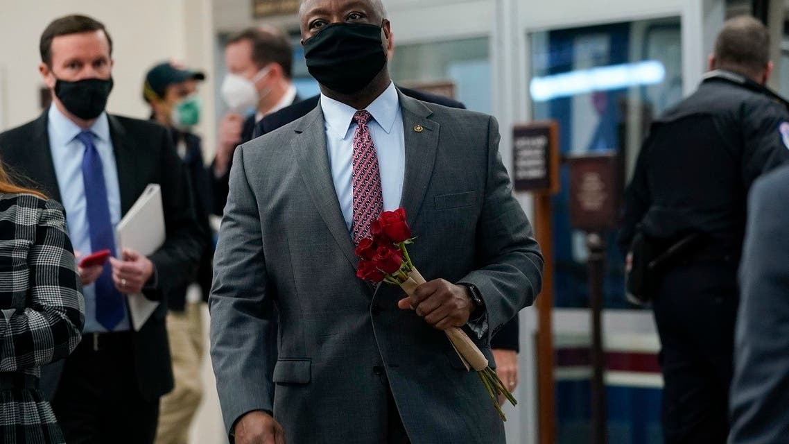 Sen. Tim Scott carries flowers as he walks on Capitol Hill, Feb. 12, 2021, on the fourth day of the second impeachment trial of former President Donald Trump. (AP)