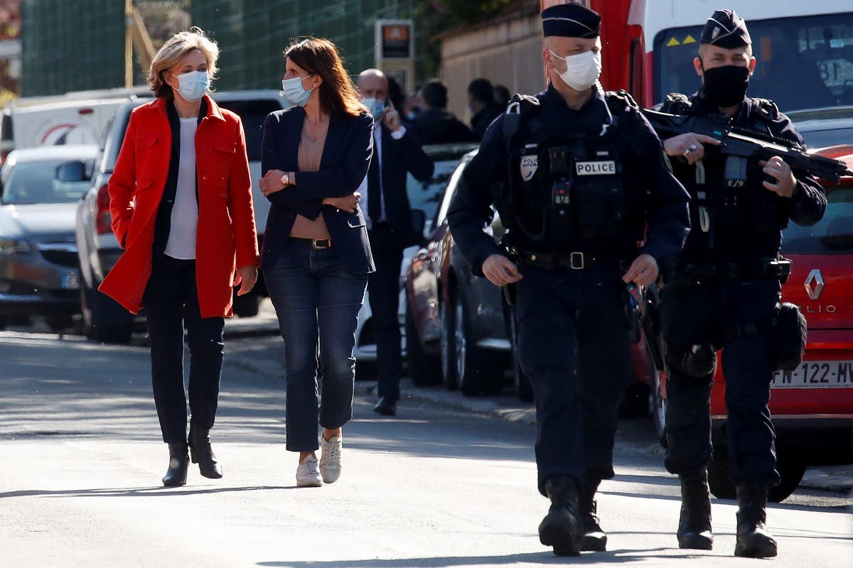 President of French Ile-de-France region Valerie Pecresse walks towards members of the media at the cordoned-off area where an attacker stabbed a female police administrative worker, in Rambouillet, near Paris, France, on April 23, 2021. (Reuters)