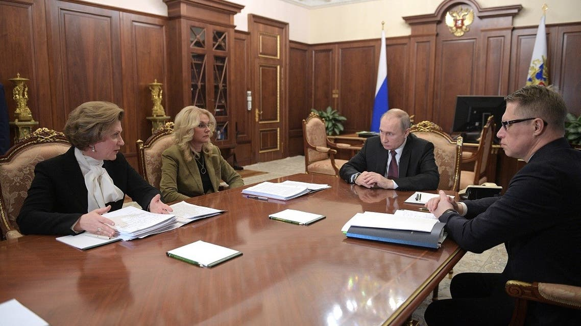 Russian President Vladimir Putin holds a meeting on preventing measures against the spread of novel coronavirus with Anna Popova, the head of Russia's consumer safety watchdog, deputy prime minister Tatyana Golikova, Health Minister Mikhail Murashko, Moscow, on January 29, 2020. (AFP)