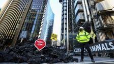 Climate activists protest, dump fake coal outside Lloyd's of London insurance market