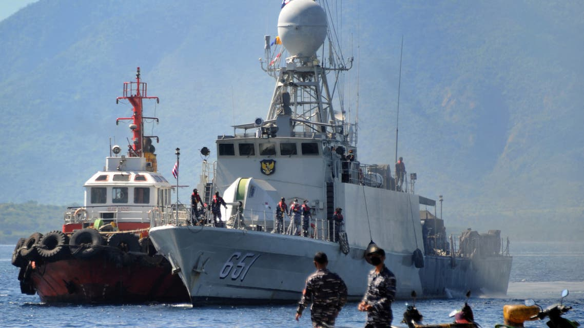The Indonesian Navy patrol boat KRI Singa (651) prepares to load provisions at the naval base in Banyuwangi, East Java province, on April 24, 2021, as the military continues search operations off the coast of Bali for the Navy's KRI Nanggala (402) submarine that went missing April 21 during a training exercise. (AFP)