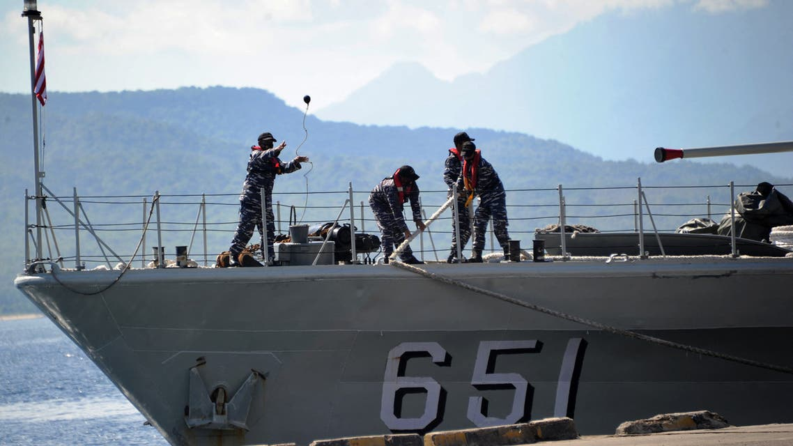 The Indonesian Navy patrol boat KRI Singa (651) prepares to load provisions at the naval base in Banyuwangi, East Java province, on April 24, 2021. (AFP)