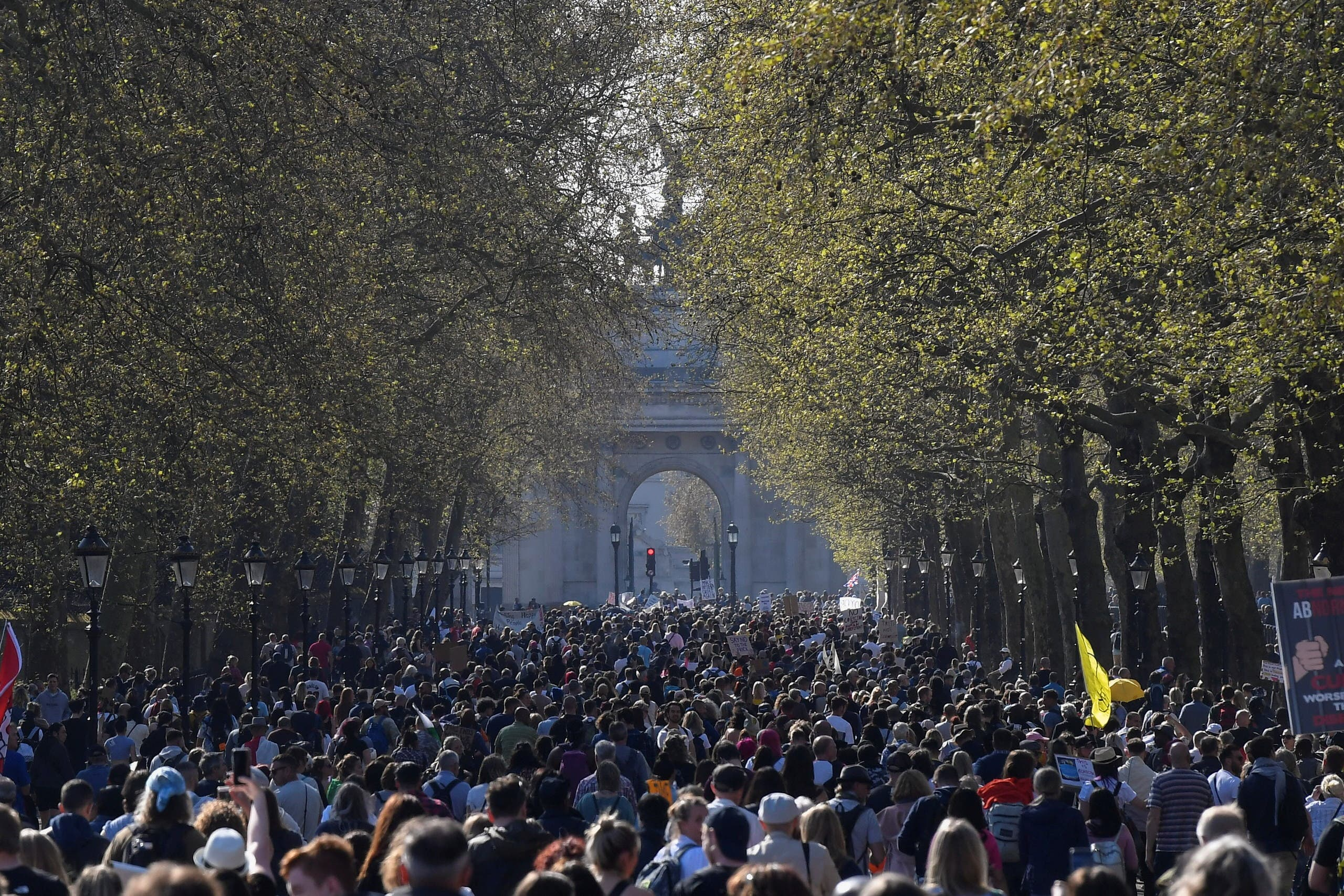 Demonstrators march during an anti-lockdown 'Unite for Freedom' protest, amid the spread of the coronavirus disease (COVID-19), in London, Britain, April 24, 2021. (Reuters)